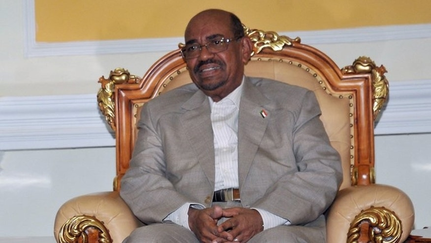 Sudanese President Omar al-Bashir attends a meeting in Khartoum on July 25, 2013. Saudi Arabia denied permission for a plane carrying Sudanese President Omar al-Bashir to travel through its airpace on Sunday for the swearing-in of the new Iranian president, Khartoum said.