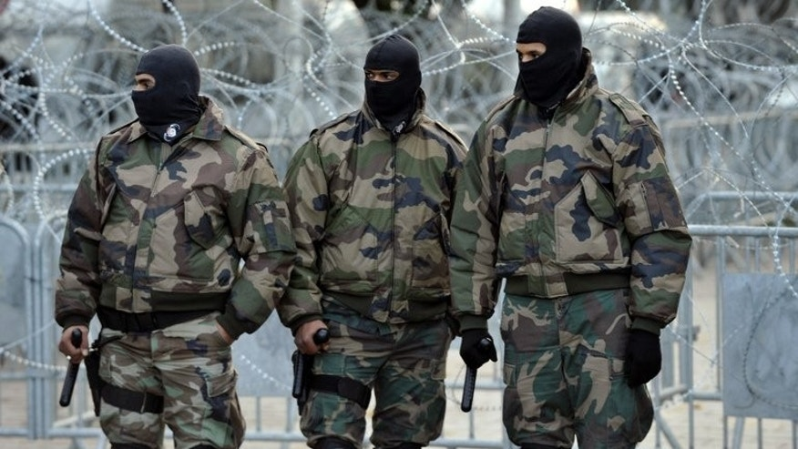 "Tunisian special security forces stand guard in Tunis on February 8, 2013. Tunisian security forces killed one ""terror"" suspect and arrested four in a dawn raid on a house south of the capital,"