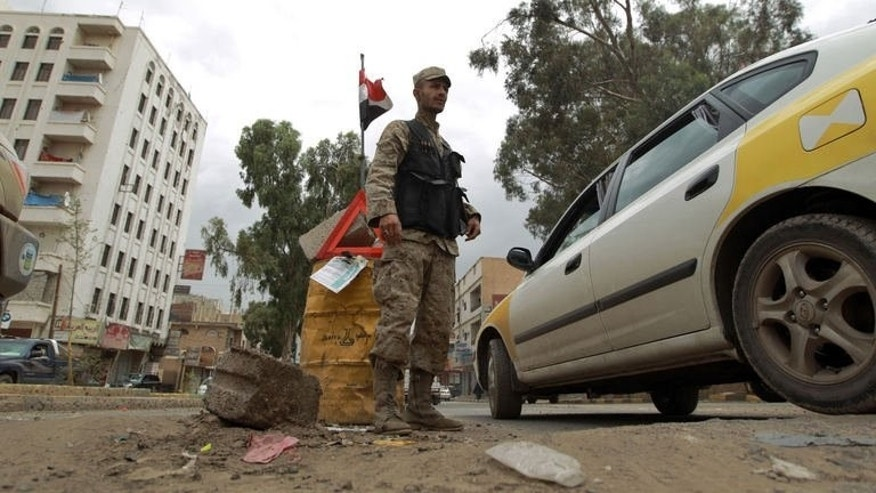 A Yemeni policeman stands at a checkpoint in Saana, on August 3, 2013.