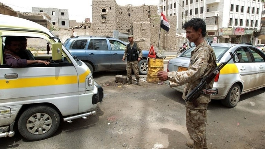 Yemeni police guard a checkpoint in Saana, on August 3, 2013.