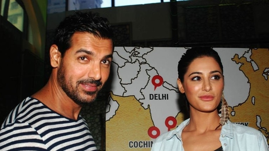 "Bollywood actors John Abraham and Nargis Fakhri ahead of a screening of the film ""Madras Cafe"", on July 11, 2013. The new spy thriller's depiction of rebels in the Sri Lankan civil war has raised concerns among India's large Tamil population."