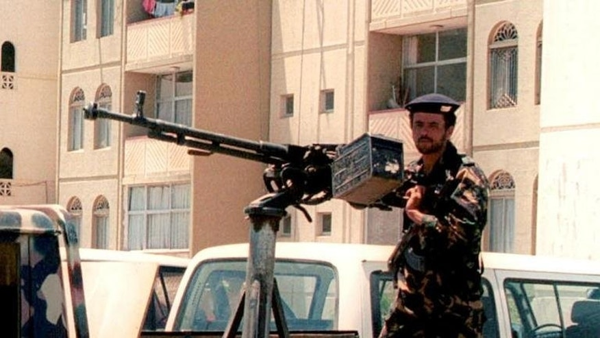 A Yemeni security officer mans a heavy gun outside the British embassy in the capital Sanaa in September 2002. Britain has said its embassy in Yemen would remain closed until the end of the Muslim festival of Eid later this week, after the United States extended the closure of its own embassies over fears of an Al-Qaeda attack.