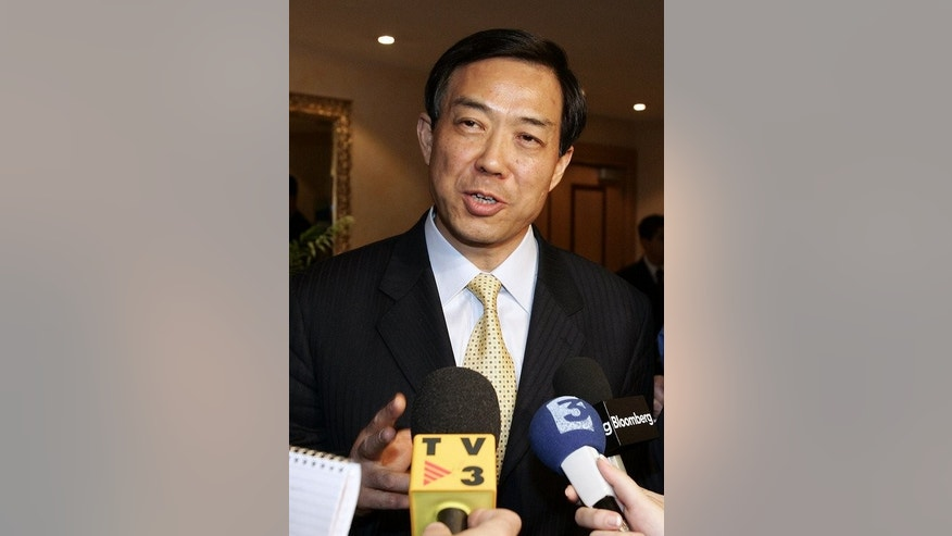 This file photo shows Bo Xilai, then serving as China's Trade Minister, pictured in Paris, on May 5, 2005. Until his downfall, Bo had been praised for transforming northeast China's city of Dalian into a development success story during the 1990s, before he moved on to head the provincial government of Liaoning and the national commerce ministry.