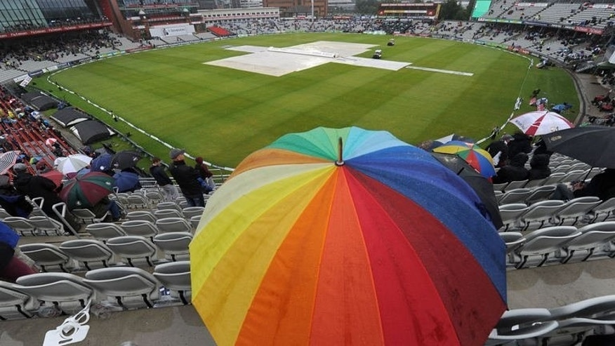 Cricket fans pictured during a rain delay on the fifth day of the third Ashes cricket Test match in Manchester, England on August 5, 2013. Rain meant only 94 minutes' play was possible.