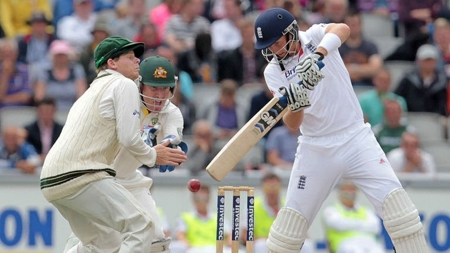 England's Joe Root bats in the fifth day of the third Ashes cricket Test match between England and Australia at Old Trafford in Manchester, England, on August 5, 2013. England captain Alastair Cook praised his side's resilience.