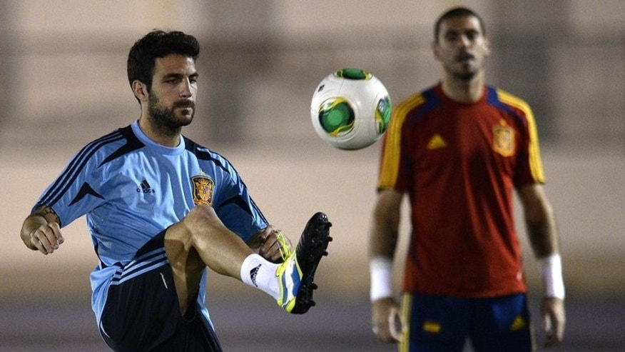 "Cesc Fabregas kicks a ball at a training session in Rio de Janeiro on June 28 during the Confederations Cup. Fabregas will resist overtures from Manchester United to stay at his ""dream"" club Barcelona, his teammate and close friend Gerard Pique said Monday."
