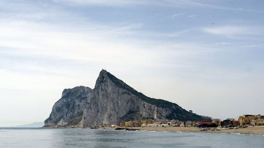 "The Rock of Gibraltar is pictured from Linea de la Concepcion, near Cadiz. Britain has vowed to carry out its ""constitutional commitments"" to the people of Gibraltar after the territory accused Spain of deliberately causing delays at the border crossing last weekend."