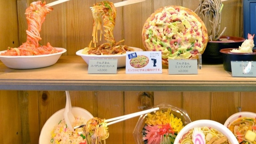Food samples made of plastic are displayed at a plastic food maker's shop in Tokyo on May 28, 2013. These fake food parades are often so similar to the real thing that they almost dare potential customers to take a bite.