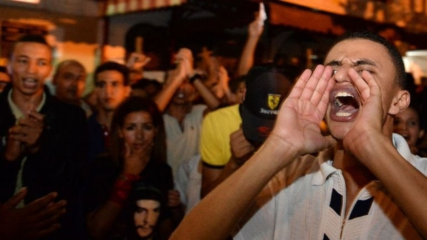 Moroccans protest against a pardon by King Mohamed VI of a Spanish paedophile, on August 5, 2013 in Kenitra. The royal pardon may have been revoked but residents of Kenitra still want to know why a man convicted of raping their children was ever released.