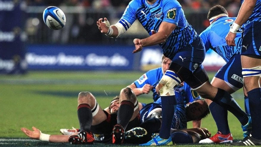 This file photo shows Jacques Potgieter making a pass during a Super 15 rugby union match in Christchurch, in 2012. The New South Wales Waratahs have pulled off a coup by announcing on Tuesday the signing of Potgieter on a two-year contract. The 27-year-old Springbok prop, is known for his physicality.