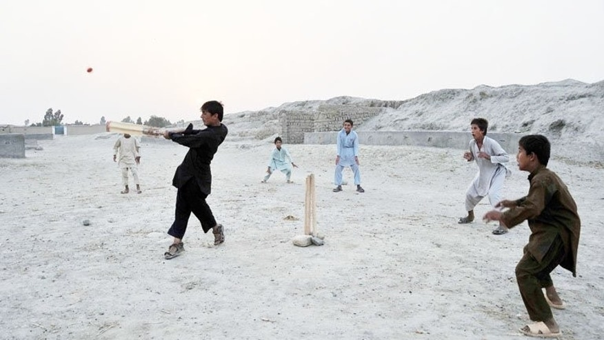 Afghan boys play cricket at sunset on the outskirts of Jalalabad on June 26. Pakistan Monday announced it will play Afghanistan in a Twenty20 international later this year to help the development of cricket in the war-ravaged nation.