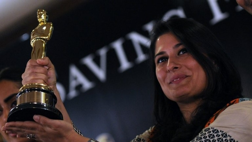 Oscar award winning Pakistani director Sharmeen Obaid-Chinoy shows her Oscar award in Karachi on March 10, 2012. Pakistan will send an entry to the Oscars for the first time in nearly 50 years as its struggling film industry shows signs of revival, the country's first Oscar winner said Monday.