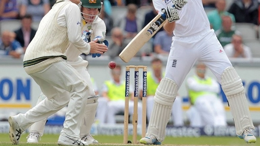 Englands Joe Root (R) bats during the fifth day of their third Ashes Test match against Australia, at Old Trafford in Manchester, north-west England, on August 5, 2013.
