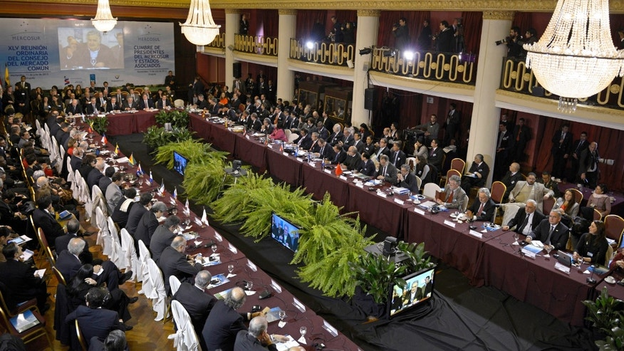 Leaders attend a Mercosur summit at the Mercosur building in Montevideo, Uruguay, Friday, July 12, 2013.