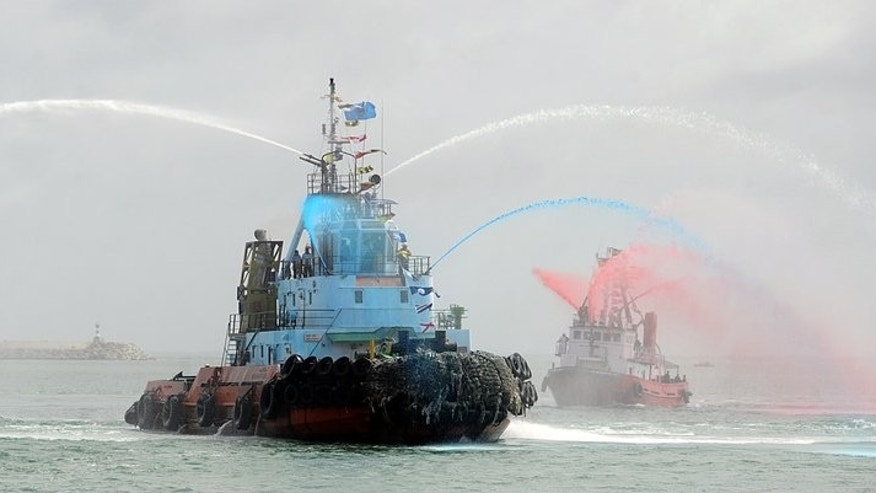 Tugs give a water display at the launch of the Chinese-built Colombo International Container Terminal on Monday. Sri Lanka launched a China-funded port which will be the island's biggest and is intended to make Colombo a strategic shipping hub along the world's most lucrative trading route.