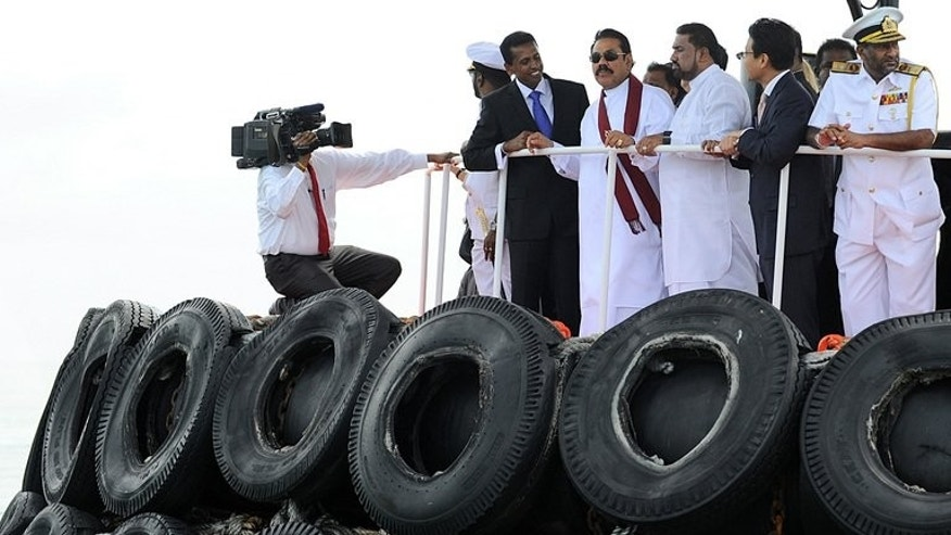 President Mahinda Rajapakse on a tug at the opening of the Colombo International Container Terminal on Monday. Rajapakse commissioned the $500 mn Chinese-built mega container terminal by symbolically loading the first container onto a ship in a ceremony broadcast live on national TV.