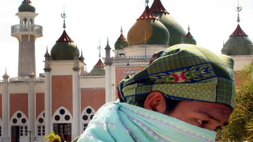 A Thai Muslim walks by the Pattani Central mosque during a demonstration in the restive Pattani province on June 4, 2007. A Muslim leader seen as a major figure in efforts to end a bloody insurgency in Thailand's south was shot dead Monday, raising concern about the future of peace talks.