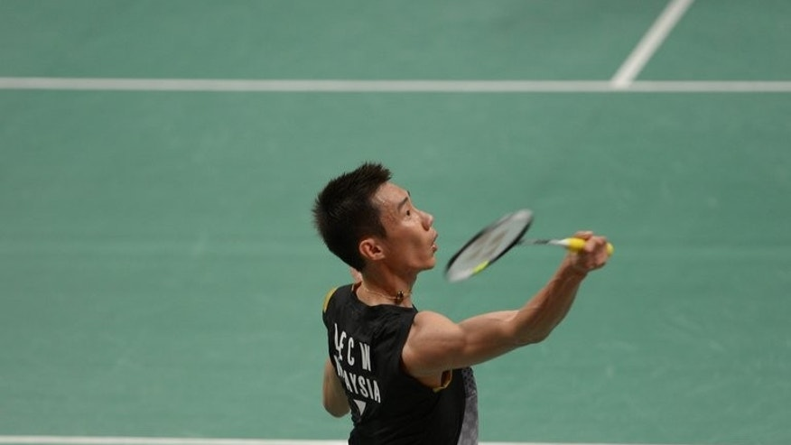 Lee Chong Wei of Malaysia plays a return during the Indonesia Open in Jakarta on June 13, 2013. Lee eased his way through the first round of the BWF World Championships on Monday, taking just 27 minutes to dismiss his opponent.