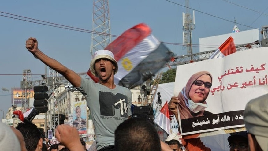 An Egyptian man shouts slogans against the army during a rally organised by the Muslim Brotherhood outside Rabaa al-Adawiya mosque in Cairo on August 4, 2013. Fresh international efforts are underway in Egypt to find a peaceful end to the crisis sparked by the military's overthrow of Islamist president Mohamed Morsi.