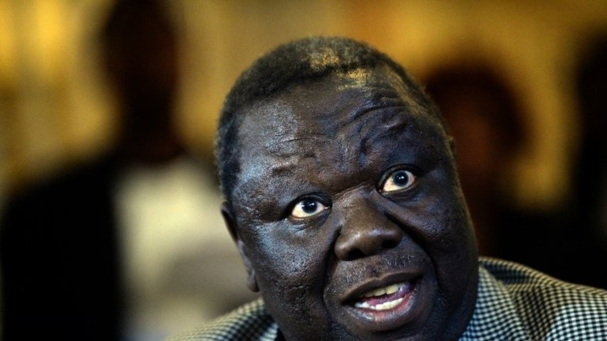 "Zimbabwe's presidential candidate Morgan Tsvangirai addresses a media conference in Harare on August 3, 2013. The defeated Tsvangirai prepared to mount a legal and political challenge against the ""sham"" election that looks set to extend Robert Mugabe's 33-year rule."