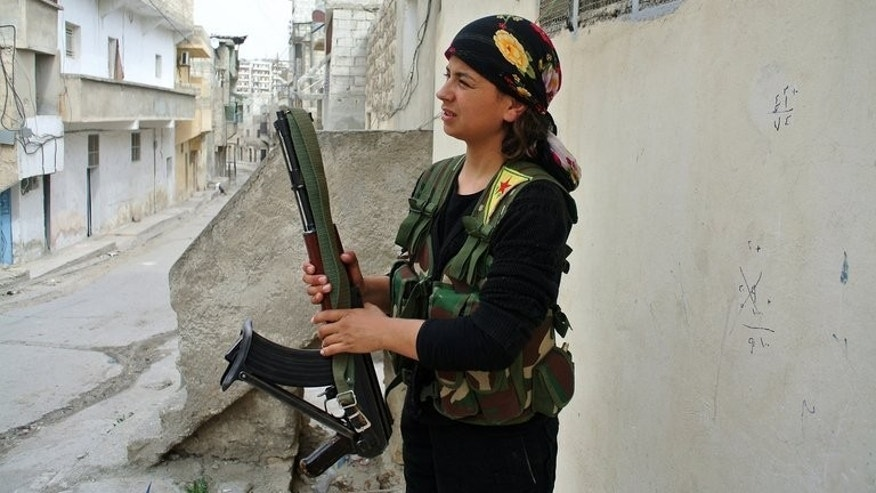 A female rebel fighter of the Syrian Kurdish Popular Protection Units holds a weapon in the Sheikh Maqsud neighbourhood of the northern Syrian city of Aleppo on May 9, 2013. After embarking on a peace process with Kurdish rebels in Turkey, Ankara is now softening its position on the increasingly autonomous Kurdish minority in war-torn neighbouring Syria, analysts say.