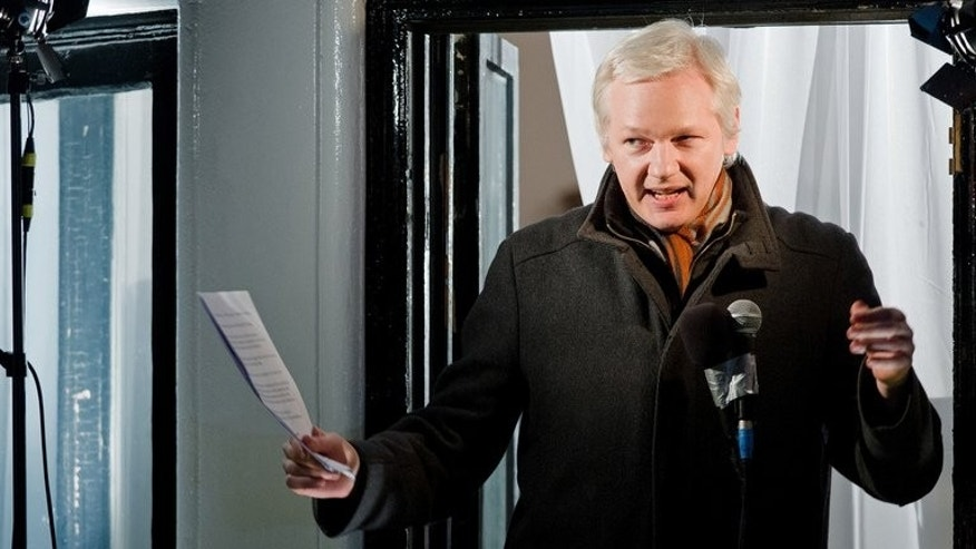 Wikileaks founder Julian Assange addresses members of the media and supporters from the window of the Ecuadorian embassy in Knightsbridge, west London, on December 20, 2012. Assange said Tuesday he had a good chance of winning election to Australia's upper house next month and pledged to give lawmakers a whistleblowing tool to report corruption.