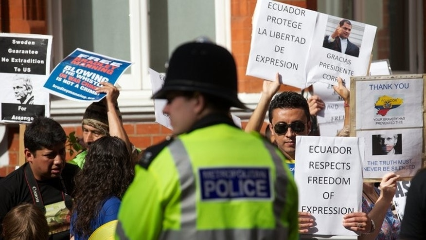 Supporters of Wikileaks founder Julian Assange hold placards during a gathering ahead of a visit of Ecuadorian Foreign Minister Ricardo Patino to the Ecuadorian embassy in London on June 16, 2013. Assange said Tuesday he had a good chance of winning election to Australia's upper house next month and pledged to give lawmakers a whistleblowing tool to report corruption.