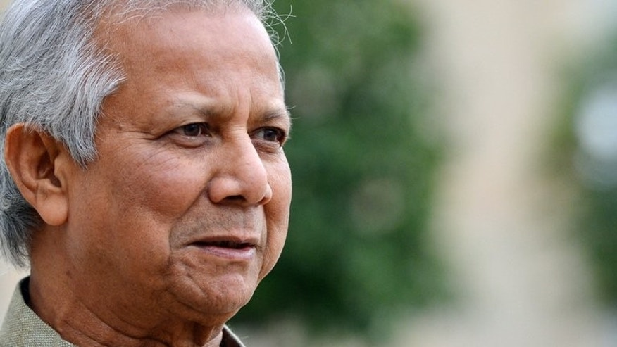 Bangladeshi economist and founder of the Grameen Bank Muhammad Yunus speaks to the press at the Elysee Palace in Paris on October 30, 2012. Bangladesh denied on Tuesday that it plans to take control of pioneering microlender Grameen Bank which has lifted millions of people out of poverty.