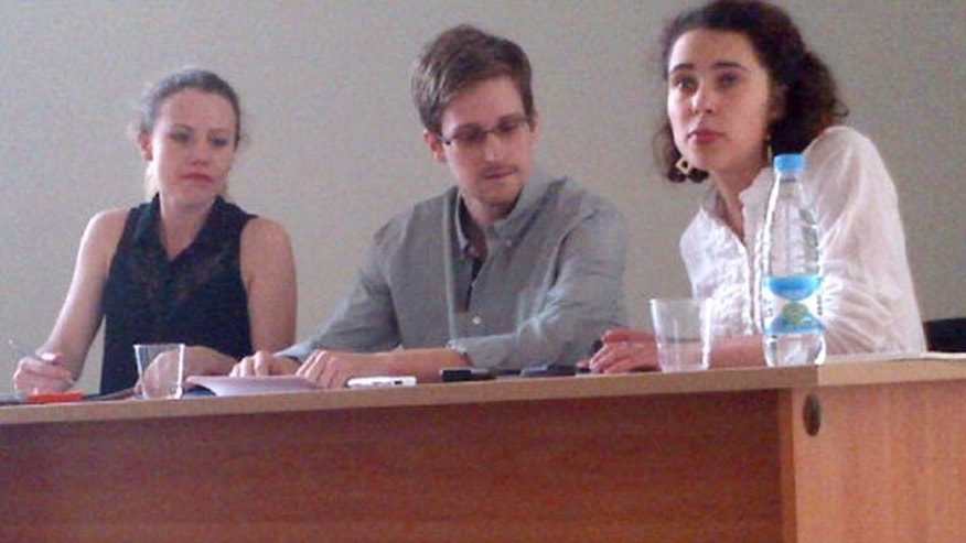 A picture released by Human Rights Watch shows Edward Snowden (C) during a meeting with rights activists, among them Sarah Harrison of WikiLeaks (L), at Moscow's Sheremetyevo airport, on July 12, 2013. Brazil-based Guardian reporter Glenn Greenwald said Tuesday that he had received nearly 20,000 secret US government documents from intelligence leaker Snowden.