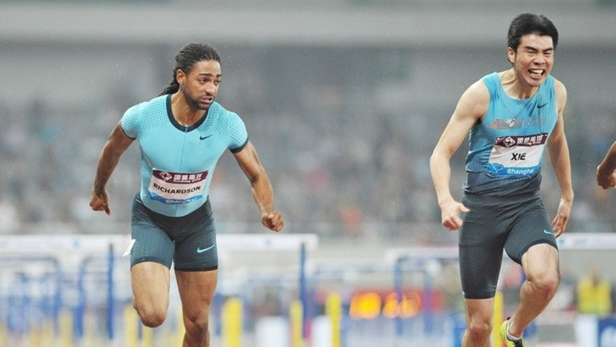 Jason Richardson of the US (left) beats Xie Wenjun of China at the Diamond League meeting in Shanghai on May 18. China's focus is squarely on Beijing 2015 as an emerging group of competitors test themselves at the world championships in Moscow.