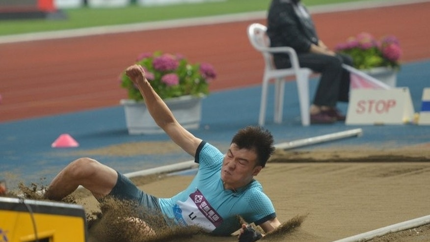 Li Jinzhe of China makes the winning jump at the Diamond League meeting in Shanghai on May 18. In the men's long jump, Li Jinzhe emerged victorious in a field including Olympic champion Greg Rutherford and Panama's Irving Saladino, the gold medallist at Beijing 2008.