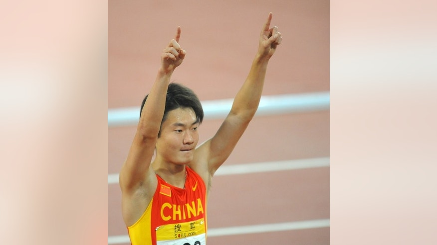 Zhang Peimeng salutes the crowd during the China Athletics Open at Beijing National stadium in May 2008. Sprinter Zhang, who has broken two national records in recent months, finished fourth in a strong men's 200m field at the Shanghai Diamond League meet in May.