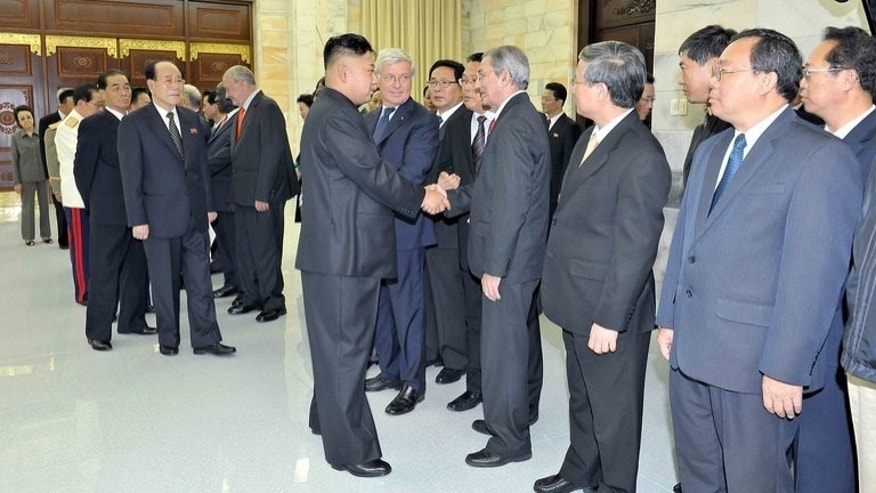 "This undated photo released by North Korea's official Korean Central News Agency (KCNA) on July 28, 2013 shows North Korean leader Kim Jong-Un (centre L) welcoming head of the International Department of the Central Committee of the Communist Party of Cuba Jose Ramon Balaguer (centre R) in Pyongyang. Cuba said it was looking forward to closer cooperation with North Korea after ""favorable"" talks."