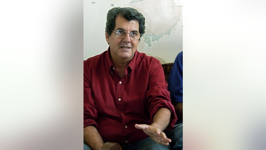 "Oswaldo Paya, leader of the Christian Liberation Movement (MCL), gives a press conference in his house in Havana on 22 November 2007. The family of late Cuban dissident Oswaldo Paya will launch a lawsuit in Spain after a Spanish politician said he did not die in a car crash but was ""assassinated"" by Cuba's secret services, Paya's brother said Tuesday."
