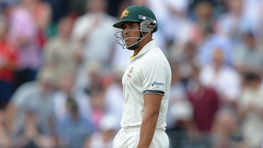 Australia's Usman Khawaja walks off after being given out during the opening day of the third Ashes Test match at Old Trafford in Manchester, on August 1, 2013. Khawaja was controversially given out even though the Decision Review System (DRS) indicates there was no noise or edge. England coach Andy Flower has called for improved use of the DRS in the last two Ashes Tests.