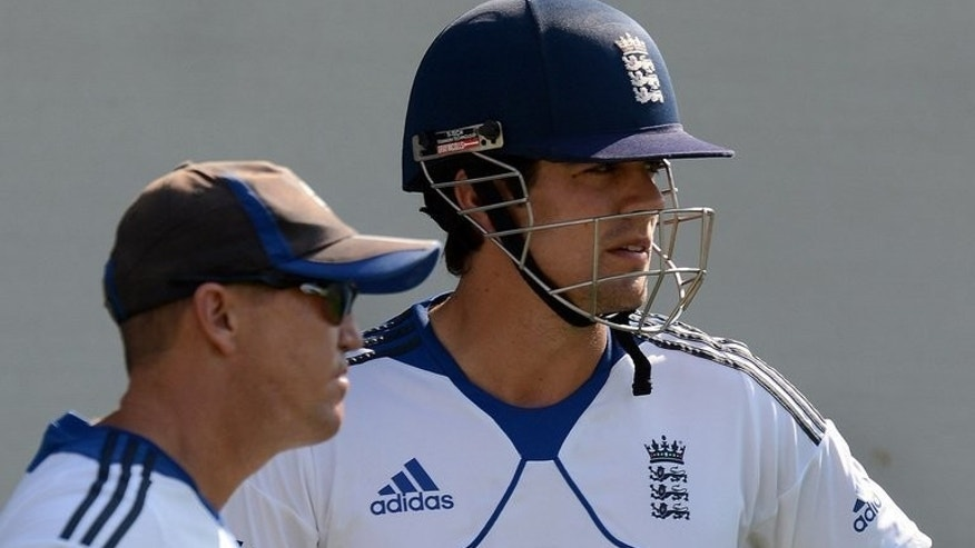 England cricket captain Alastair Cook (right) speaks with coach Andy Flower during a training session in Ahmedabad, on November 13, 2012. Flower has joined the captains of both sides in calling for improved use of the Decision Review System (DRS) in the remaining two Ashes Tests against Australia.