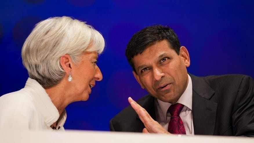Raghuram Rajan with International Monetary Fund chief Christine Lagarde in Tokyo last October. India on Tuesday named the former IMF chief economist as its new central bank governor as it grapples with a plunging currency and the slowest growth in a decade.