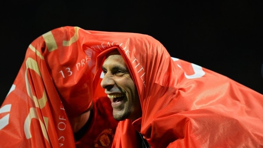 Manchester United's English defender Rio Ferdinand celebrates at Old Trafford in Manchester on April 22, 2013. Ferdinand has revealed that he and his team-mates find transfer speculation every bit as intriguing as the supporters in the stands.