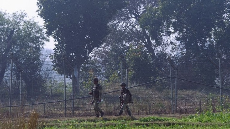Indian Border Security Force soldiers patrol southwest of Jammu, on January 20, 2013. Pakistani troops killed five Indian soldiers in an attack on a military post in Indian Kashmir, Indian officials said Tuesday.