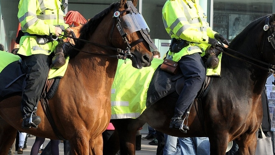 File picture for illustration shows police horses at a football match in Manchester, northwest England. Blackpool manager Paul Ince has called for tighter security at English grounds after crowd trouble marred his side's 1-0 loss at Preston North End in the League Cup.