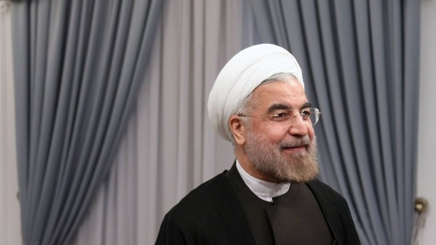 "Iran's new president Hassan Rowhani pictured on his first official day in office in Tehran, on August 3, 2013. Rowhani says Tehran is ready for ""serious"" negotiations on its nuclear programme with the major powers ""without wasting time""."