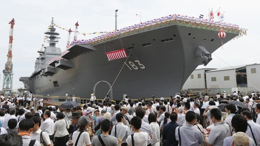 "Aug. 6, 2013: Japan's new warship ""Izumo,"" which has a flight deck that is nearly 820 feet long, is unveiled in Yokohama, south of Tokyo."