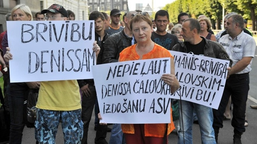 Aug. 6, 2013: Suporters of Deniss Calovskis protest against his extradition to the United States in Riga, Latvia.