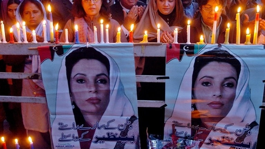 Supporters of the Pakistan People's Party (PPP) hold a candle vigil in the memory of slain former premier Benazir Bhutto, in Lahore, on December 31, 2007. Bhutto, twice elected prime minister of Pakistan, was assassinated four days earlier in a gun and bomb attack after campaigning in the garrison city of Rawalpindi.