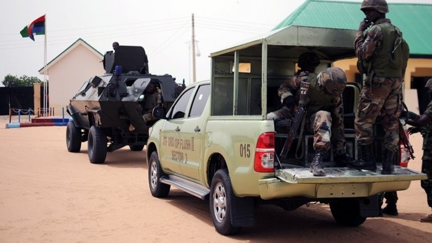 Nigerian soldiers ready for a patrol in the north of Borno state on June 5. Clashes broke out in the town of Gamboru Ngala on the border with Cameroon on Monday night and continued on Tuesday, a resident said. The military had not commented on the situation there and details remained unclear.