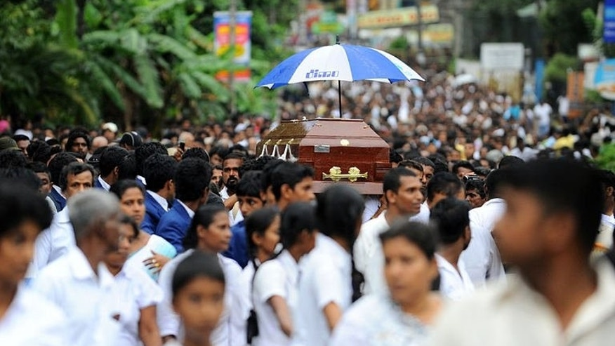 Sri Lankan students carry the coffin of their colleague, Akila Dinesh Jayawardena who was shot dead during an army crackdown against people protesting tainted ground water in the village of Weliweriya on August 4, 2013. Sri Lanka's opposition Tuesday demanded an international investigation into a deadly army crackdown on villagers who were demonstrating against contaminated water supplies.