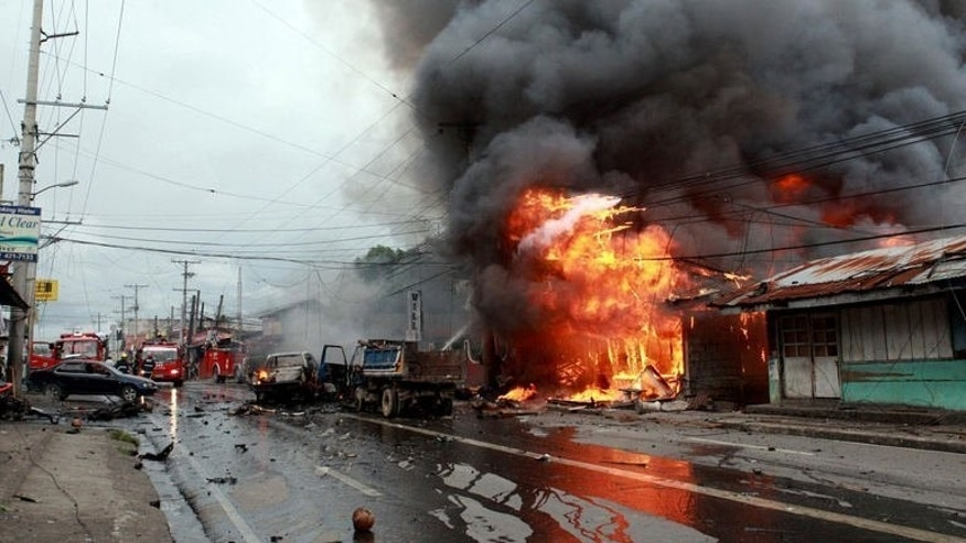A building on fire after a bomb explosion in Cotabato city, on the southern Philippines island of Mindanao on August 5, 2013. The death toll from the powerful blast rose to eight on Tuesday, police said, as officials pointed to political rivalry as a possible motive.