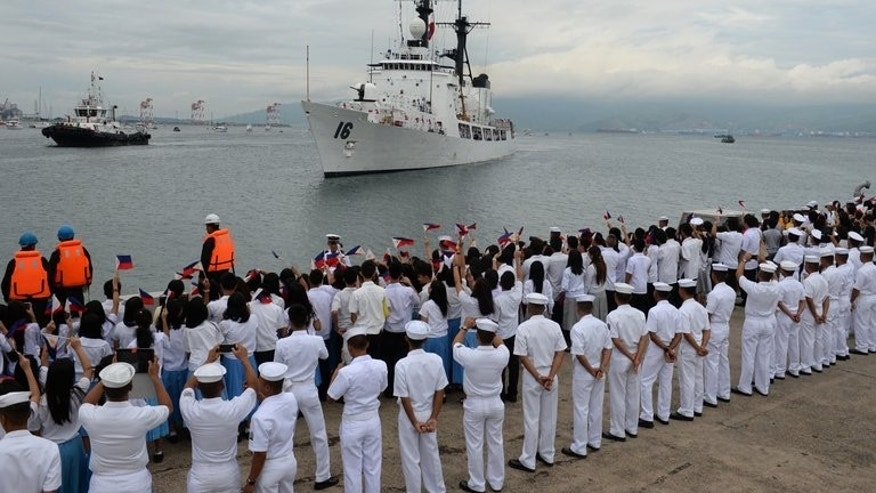 The Philippine Navy high-endurance Hamilton-class cutter, the BRP Ramon Alcaraz, that had been decomissioned by the US Coast Guard and acquired by Manila, is welcomed as it arrives at the former US naval base in Subic Bay, Zambales province, northwest of Manila, on August 6, 2013.