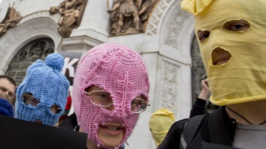 Supporters of punk group Pussy Riot, wearing the group's trademark coloured balaclavas, outside the Church of Christ the Saviour in central Moscow on August 15, 2012. A man stabbed to death a Russian priest who was deeply critical of Orthodox Church leadership and had supported the activist punk rock group Pussy Riot, police said on Tuesday.