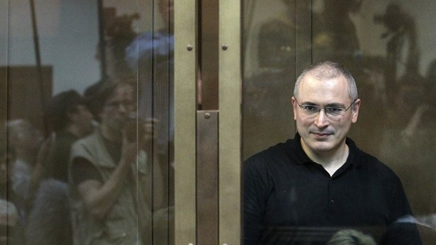 Mikhail Khodorkovsky stands behind a glass wall at a courtroom in Moscow on May 24, 2004. Russia's supreme court on Tuesday trimmed by two months the 11-year prison camp term of former oil tycoon Khodorkovsky over a conviction which supporters say was ordered by the Kremlin.